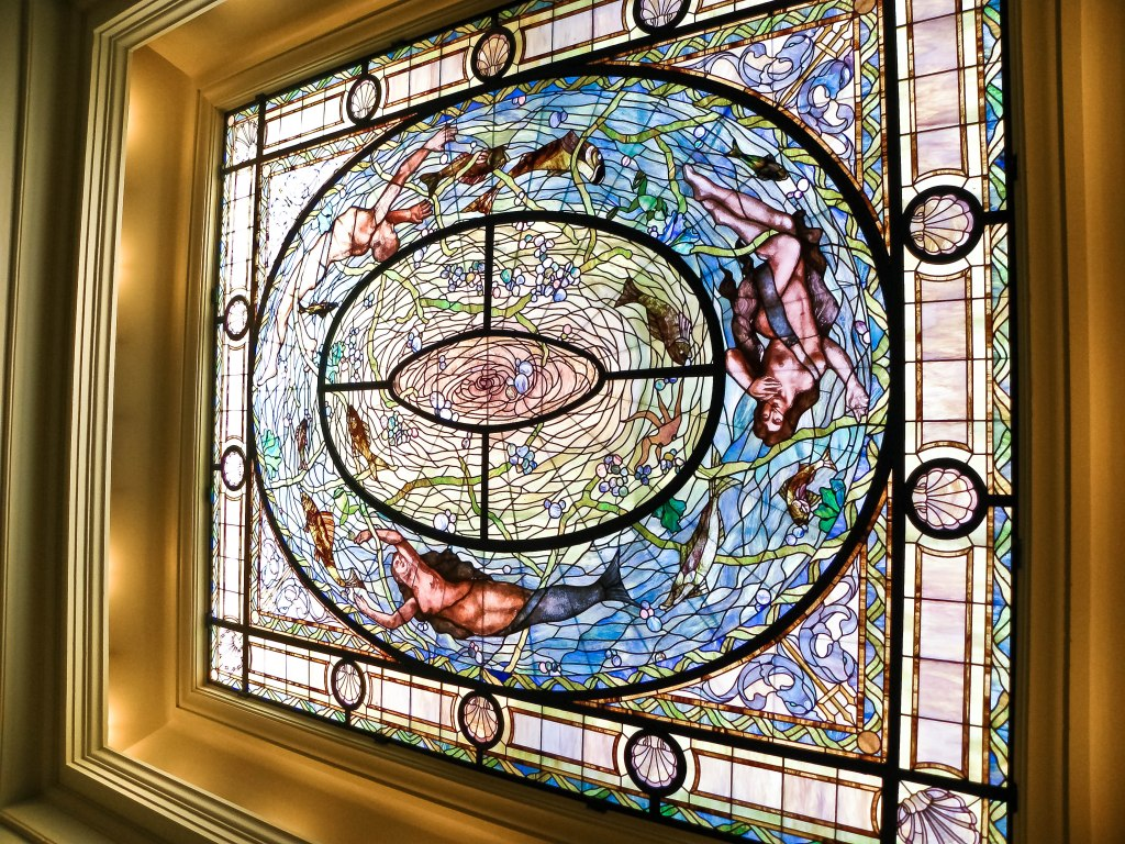 stained glass in Fordyce mens' room